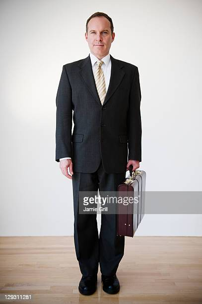 USA, New Jersey, Jersey City, Portrait of businessman with briefcase