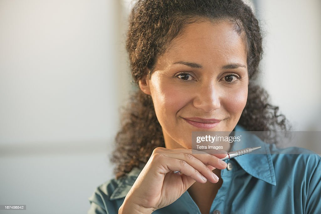 USA, New Jersey, Jersey City, Portrait of businesswoman in office  : Stock Photo