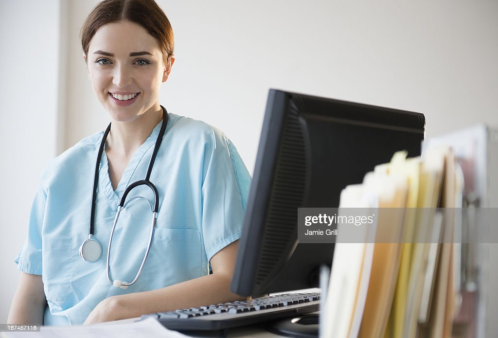 USA, New Jersey, Jersey City, Portrait of female doctor in hospital uniform : Stock Photo