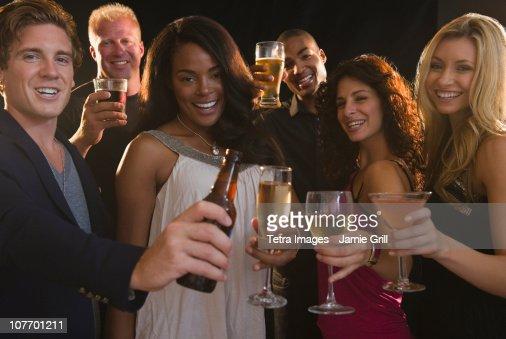 USA, New Jersey, Jersey City, Portrait of friends celebrating with champagne at nightclub : Stock Photo