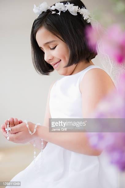 USA, New Jersey, Jersey City, Portrait of girl (8-9) celebrating Fist Communion