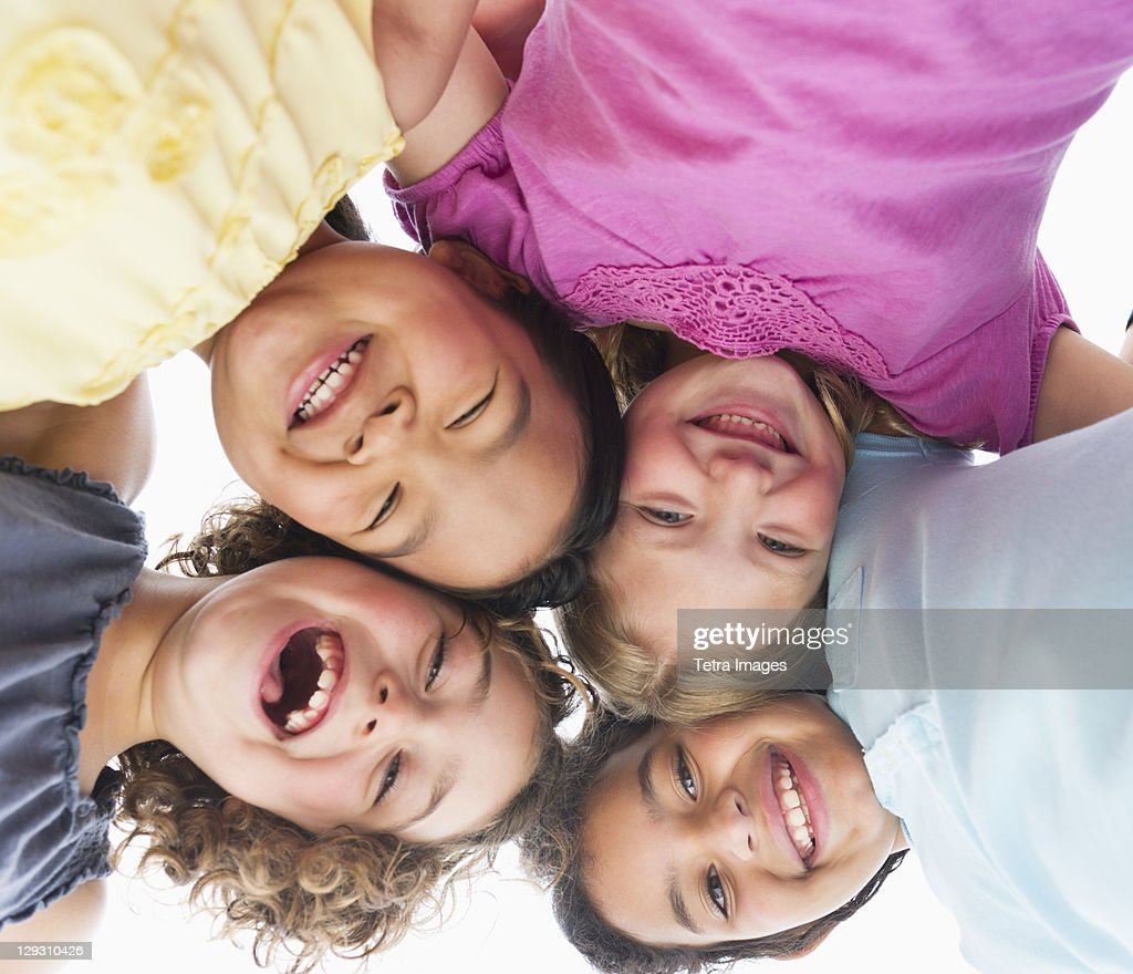 USA, New Jersey, Jersey City, Portrait of girls (6-9) in huddle : Stock Photo