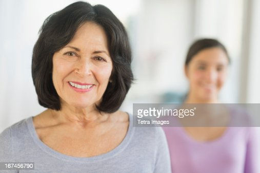 USA, New Jersey, Jersey City, Portrait of grandmother and granddaughter (16-17) : Stock Photo