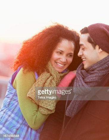 USA, New Jersey, Jersey City, Portrait of happy couple embracing at sunset : Stock Photo