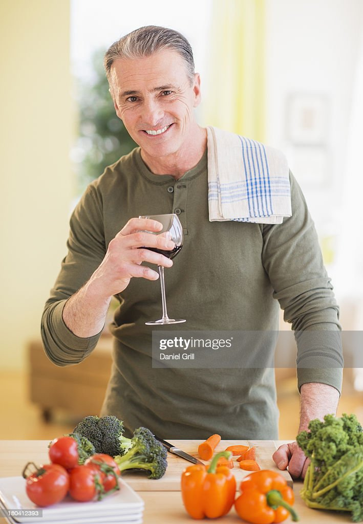 USA, New Jersey, Jersey City, Portrait of man in kitchen, holding wine glass : Stock Photo