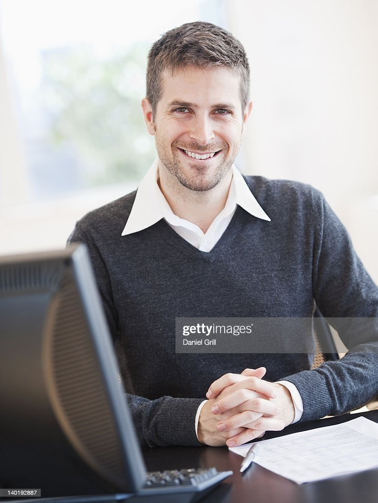 USA, New Jersey, Jersey City, Portrait of man in office : Stock Photo