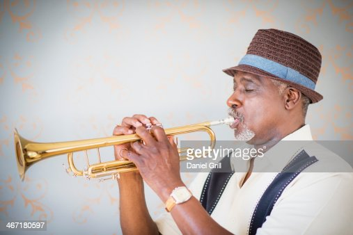 USA, New Jersey, Jersey City, Portrait of man playing trumpet