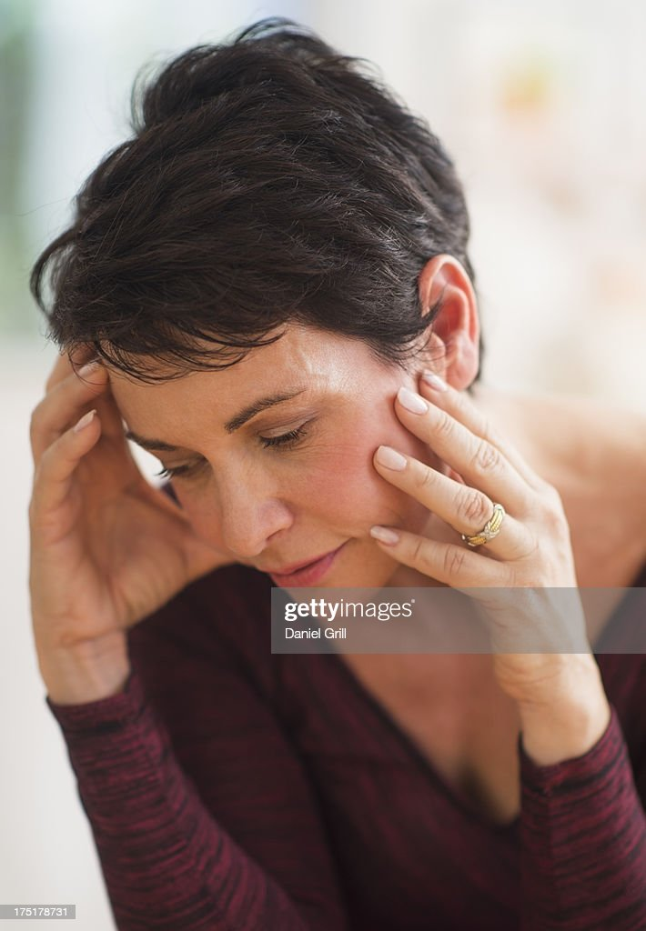 USA, New Jersey, Jersey City, Portrait of mature woman with hands on head : Stock Photo