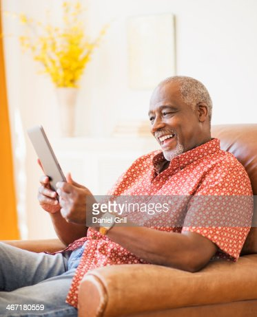 USA, New Jersey, Jersey City, Portrait of men using digital tablet