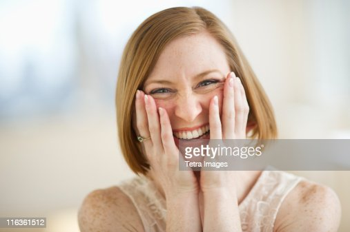 USA, New Jersey, Jersey City, portrait of mid adult woman smiling : Stock Photo