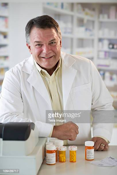 USA, New Jersey, Jersey City, Portrait of pharmacist selling medication in pharmacy
