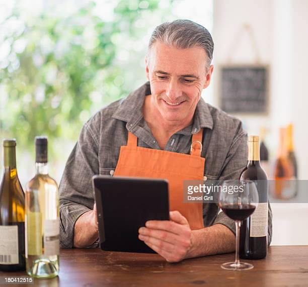 USA, New Jersey, Jersey City, Portrait of restaurant owner using digital tablet