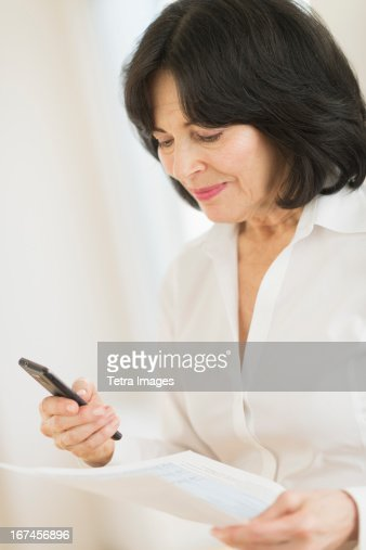 USA, New Jersey, Jersey City, Portrait of senior businesswoman texting on mobile : Stock Photo