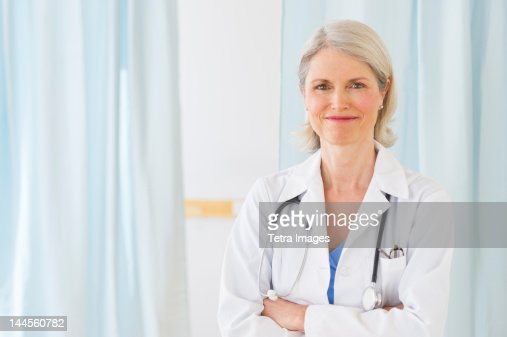 USA, New Jersey, Jersey City, Portrait of senior female doctor  in her office : Stock Photo