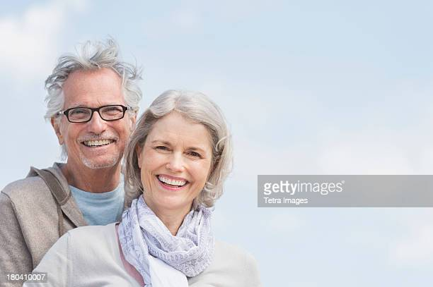 USA, New Jersey, Jersey City, Portrait of senior smiling outdoors