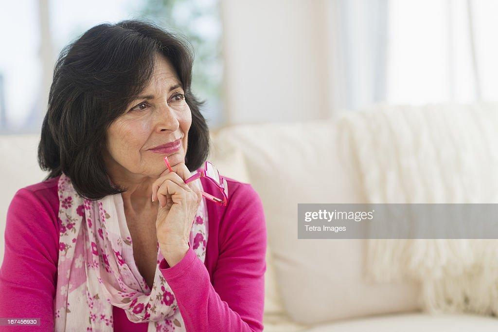 USA, New Jersey, Jersey City, Portrait of senior woman contemplating : Stock Photo
