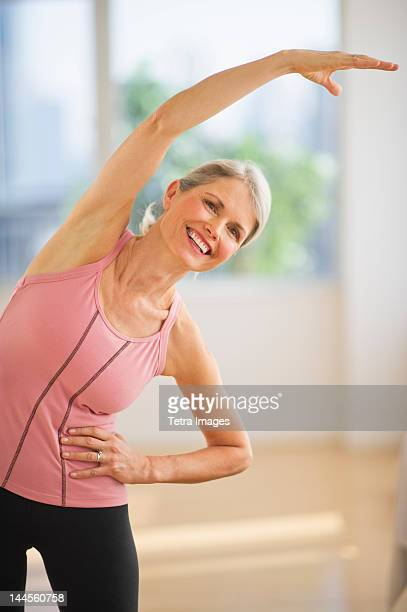 USA, New Jersey, Jersey City, Portrait of senior woman exercising in gym