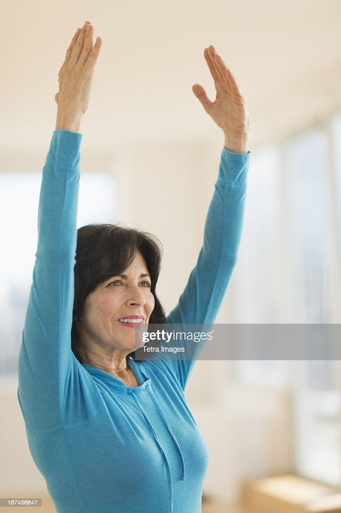 USA, New Jersey, Jersey City, Portrait of senior woman exercising : Stock Photo