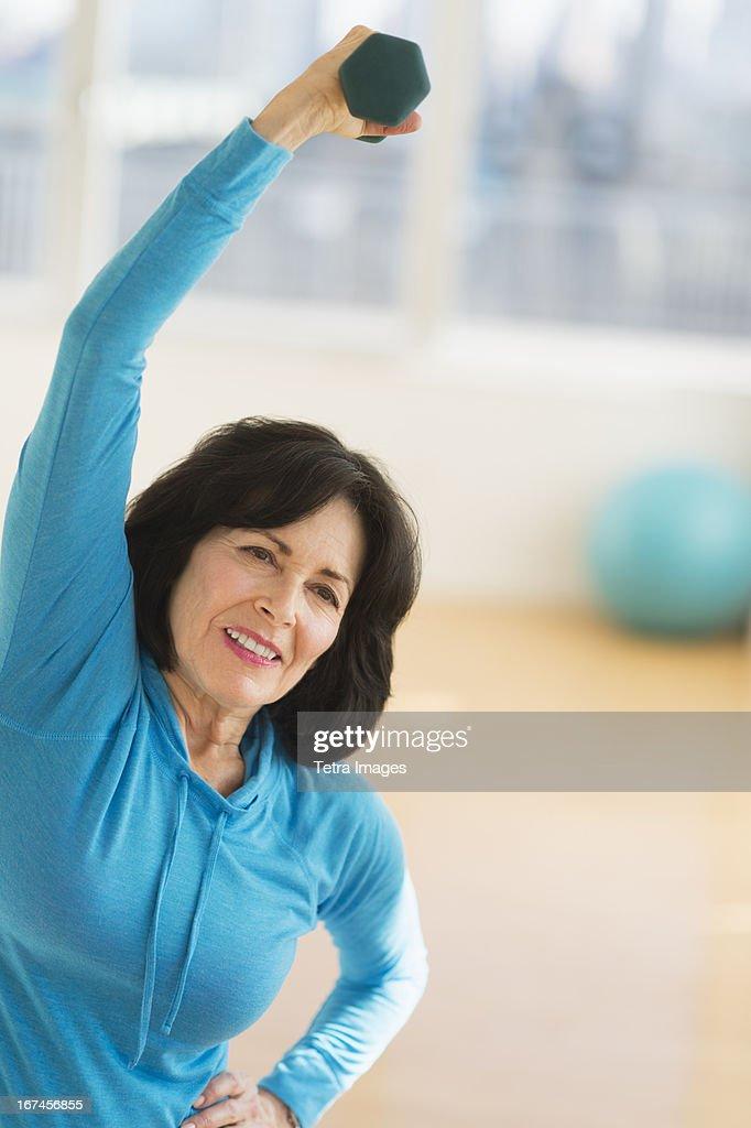 USA, New Jersey, Jersey City, Portrait of senior woman exercising : Stock Photo