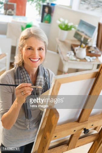 USA, New Jersey, Jersey City, Portrait of senior woman painting on canvas : Stock Photo