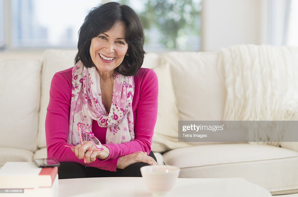 USA, New Jersey, Jersey City, Portrait of senior woman sitting in living room : Stock Photo