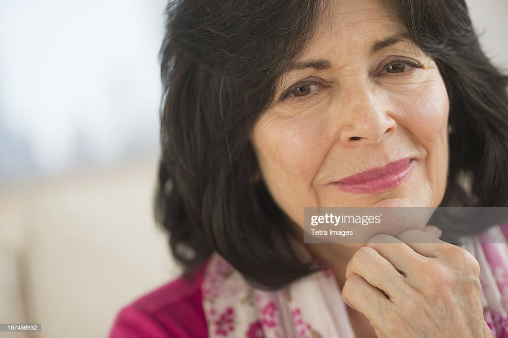 USA, New Jersey, Jersey City, Portrait of senior woman wearing pink : Stock Photo