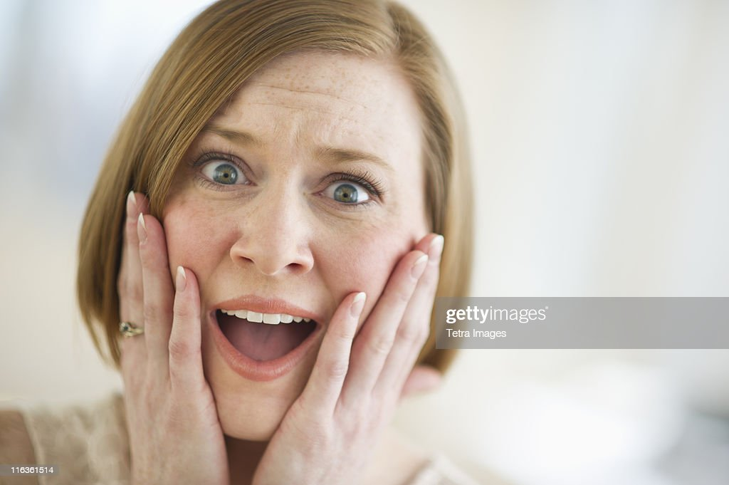 USA, New Jersey, Jersey City, portrait of shocked woman : Stock Photo