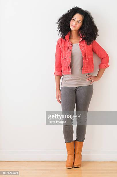 USA, New Jersey, Jersey City, Portrait of smiling mid adult woman standing against wall
