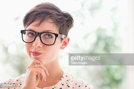 USA, New Jersey, Jersey City, Portrait of smiling woman wearing eyeglasses