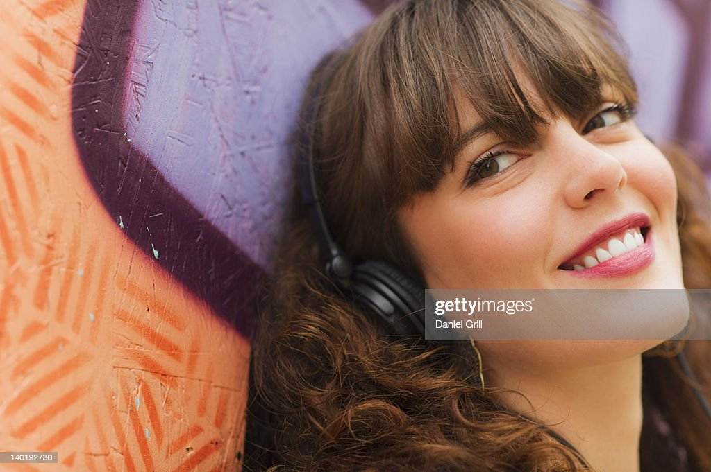 USA, New Jersey, Jersey City, Portrait of smiling woman with headphones
