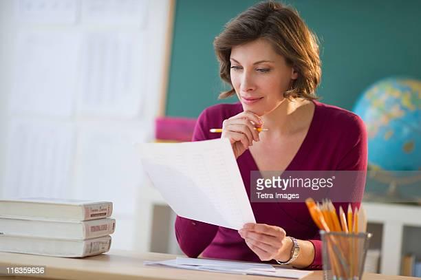 USA, New Jersey, Jersey City, portrait of teacher at desk in classroom