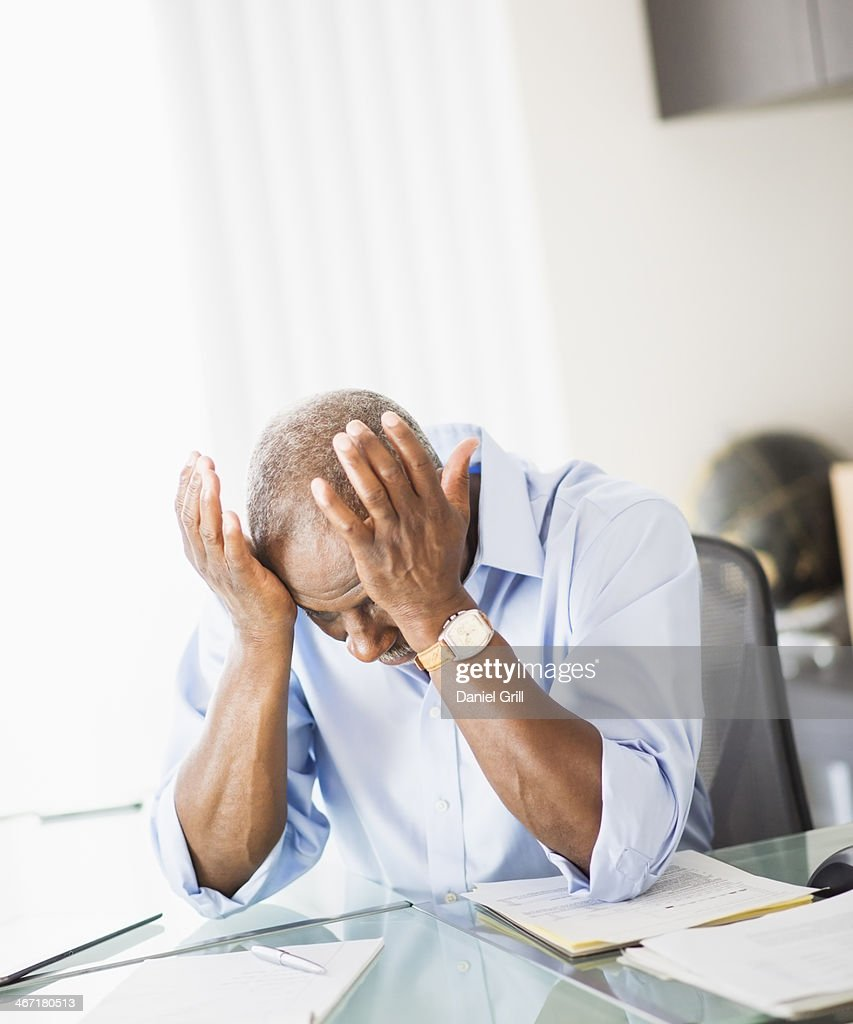 USA, New Jersey, Jersey City, Portrait of tired senior man in office