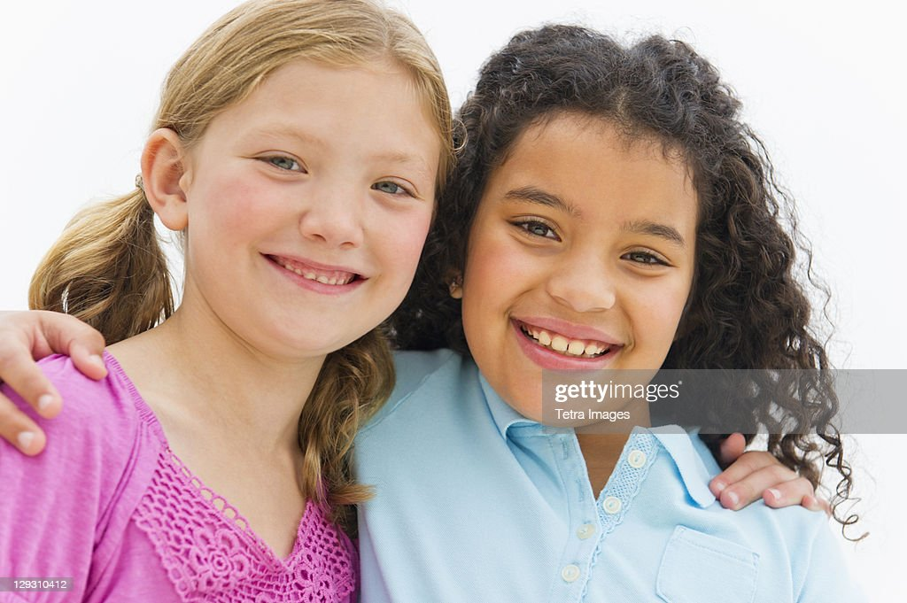 USA, New Jersey, Jersey City, Portrait of two girls (8-9) embracing : Stock Photo