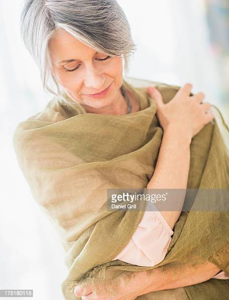 USA, New Jersey, Jersey City, Portrait of woman covered with scarf