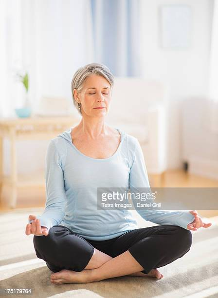USA, New Jersey, Jersey City, Portrait of woman doing yoga