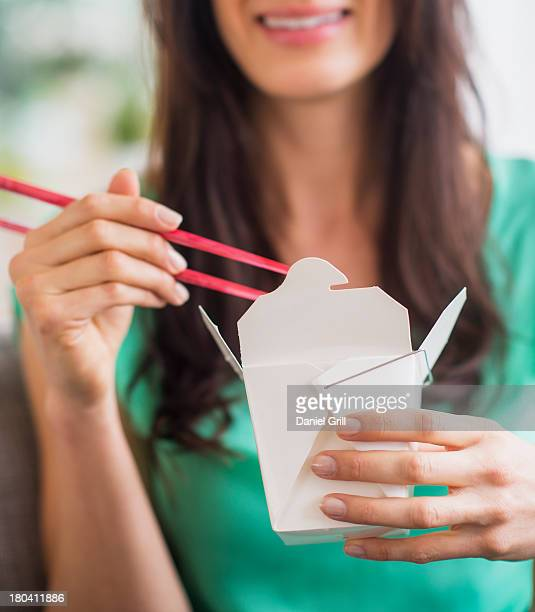 USA, New Jersey, Jersey City, Portrait of woman eating take out food