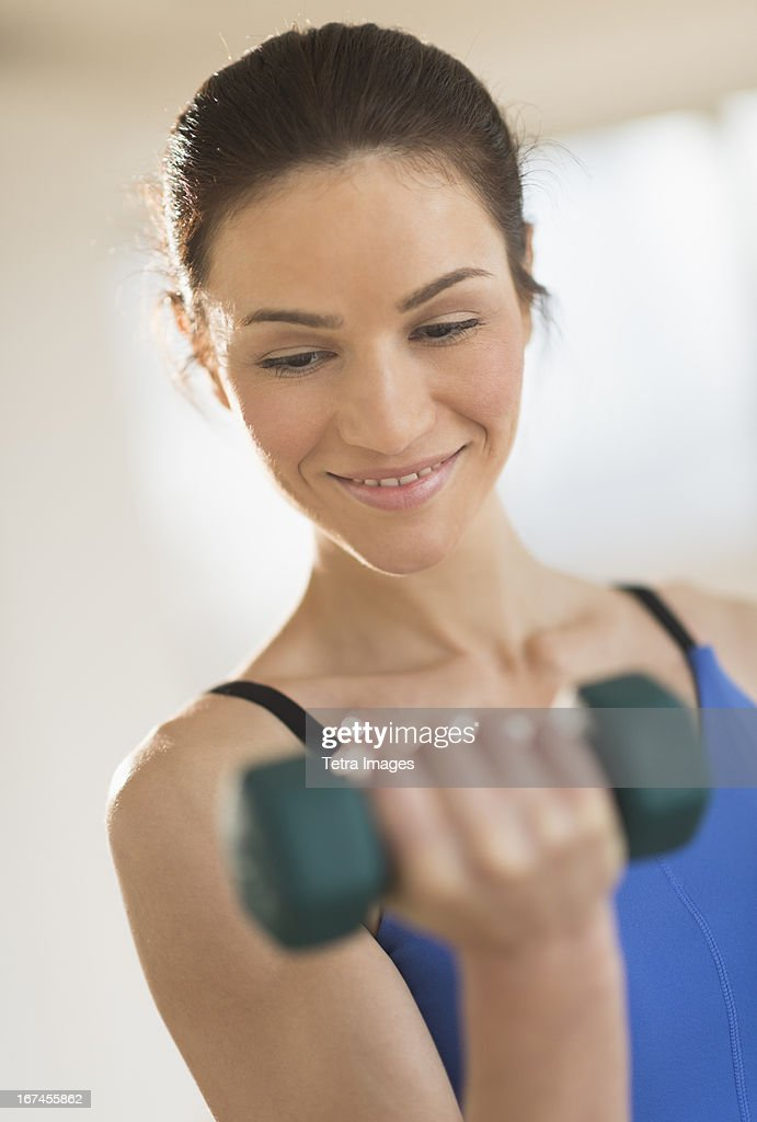 USA, New Jersey, Jersey City, Portrait of woman lifting weights : Stock Photo