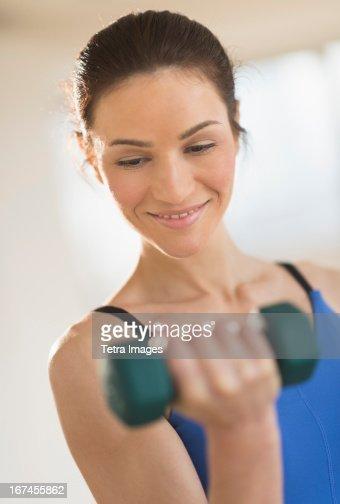 USA, New Jersey, Jersey City, Portrait of woman lifting weights : Stock Photo