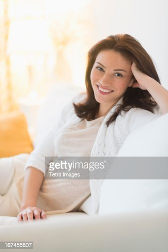 USA, New Jersey, Jersey City, Portrait of woman sitting on sofa : Stock Photo
