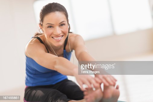 USA, New Jersey, Jersey City, Portrait of woman stretching in gym : Stock Photo