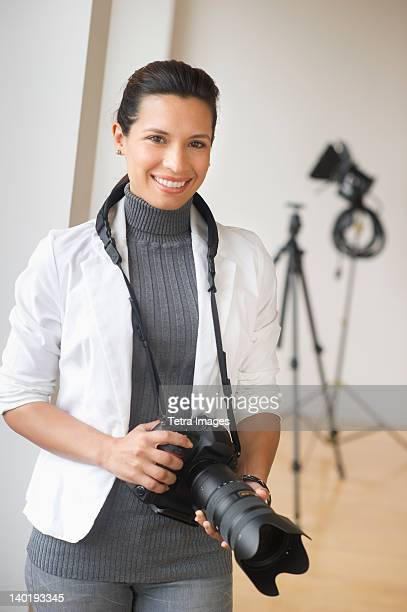 USA, New Jersey, Jersey City, Portrait of woman with digital camera