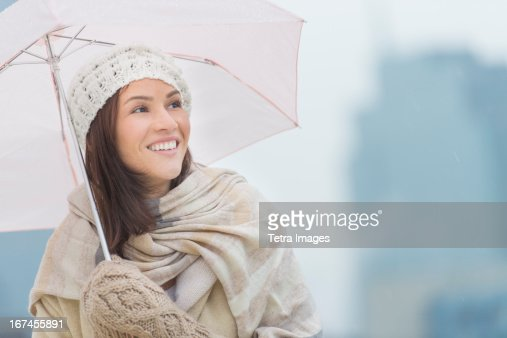 USA, New Jersey, Jersey City, Portrait of woman with umbrella : Stock Photo