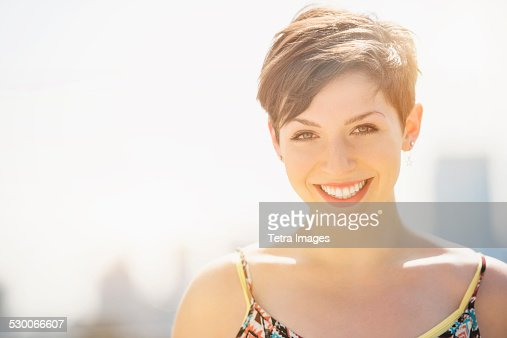 USA, New Jersey, Jersey City, Portrait of young smiling woman