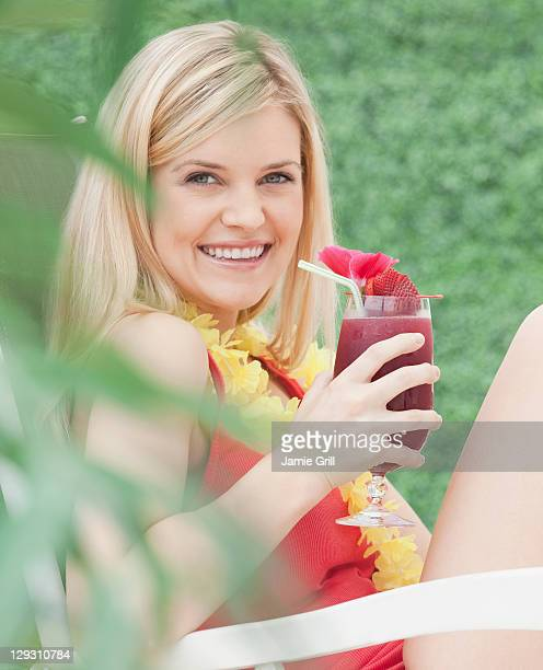 USA, New Jersey, Jersey City, Portrait of young woman drinking cocktail