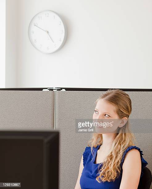 USA, New Jersey, Jersey City, Portrait of young woman in office