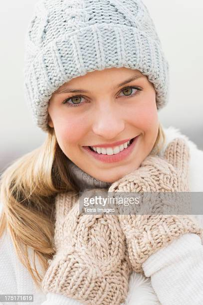 USA, New Jersey, Jersey City, Portrait of young woman in winter clothing
