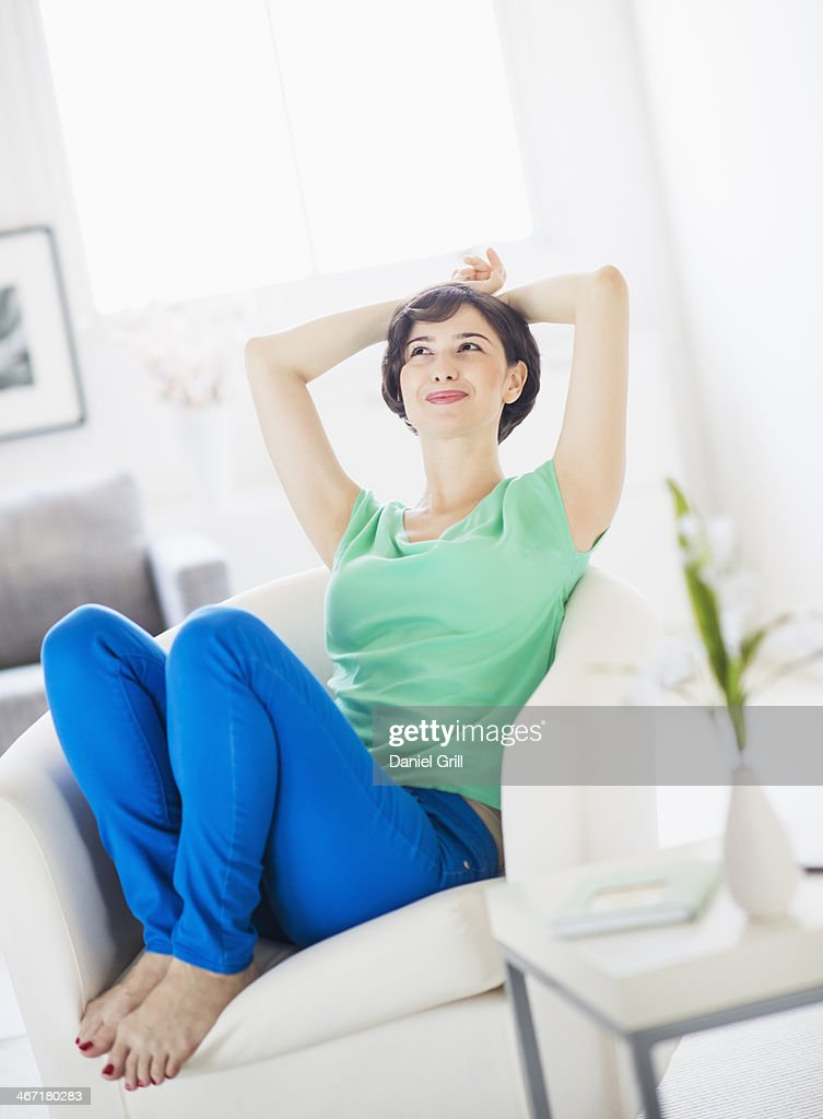 USA, New Jersey, Jersey City, Portrait of young woman relaxing at home