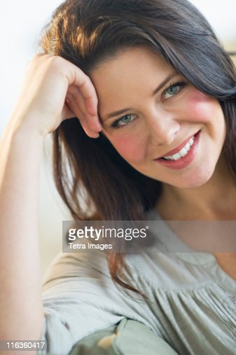 USA, New Jersey, Jersey City, portrait of young woman smiling : Stock Photo