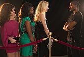 USA, New Jersey, Jersey City, Queue of women waiting near bouncer
