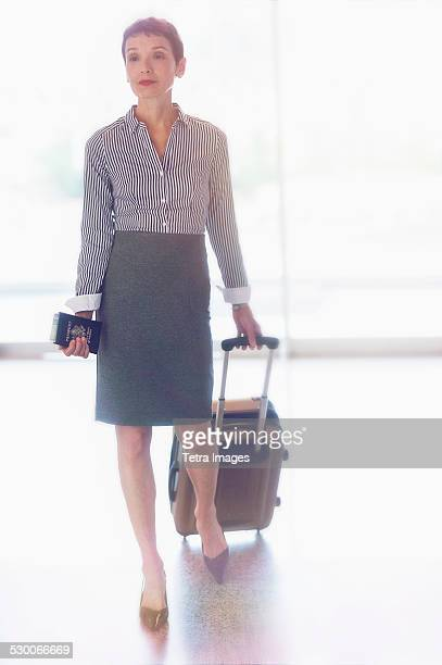 USA, New Jersey, Jersey City, Senior business woman in airport